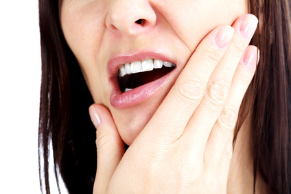 Woman with a toothpain, isolated on white